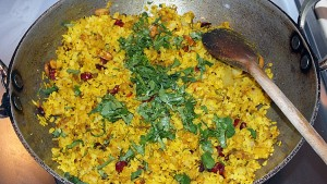 A wok-ful of poha makes for a nutritious family breakfast