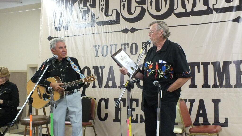 Bob Everhart giving and award to Harry Rusk